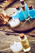 picture of gels  - Spa still life with starfish and bottles of shower gel on wooden background - JPG