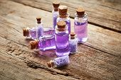stock photo of gels  - Bottles with purple shower gel on wooden background - JPG