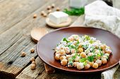 pic of chickpea  - salad with chickpeas feta and parsley on a dark wood background