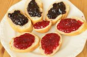 picture of baguette  - Baguette slices with raspberry and blueberry jam