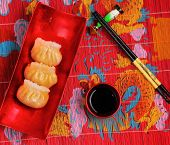 foto of siomai  - steamed shrimp dumplings served on a traditional bamboo place mat - JPG