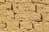 stock photo of mud  - close up of old mud brick wall - JPG