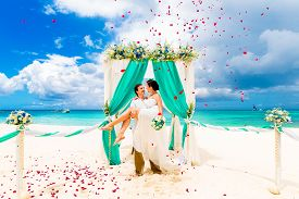 picture of marriage ceremony  - Wedding ceremony on a tropical beach in blue - JPG