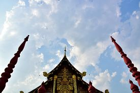 stock photo of canopy roof  - cloud on Sky shine  over the roof of the castle - JPG