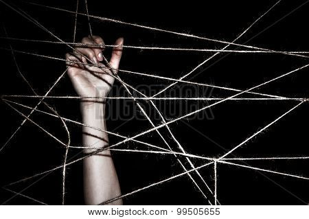 Slim Hand Behind The Interlaced Ropes