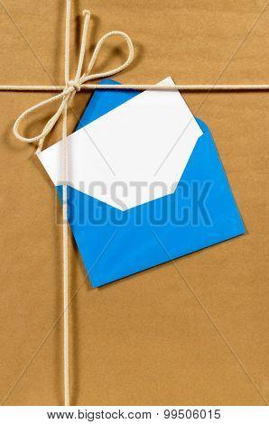 Brown Paper Parcel With Blue Envelope