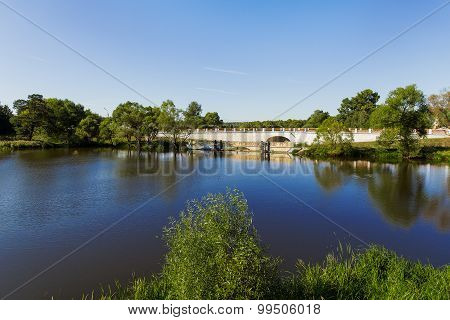 Old Bridge In Bolshie Vyazyomy Manor, Moscow Region, Russia. Natural Landscape Background With Lake.