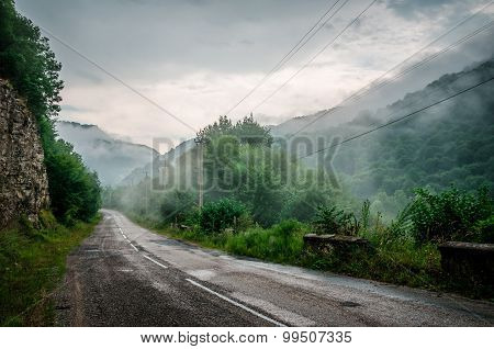 Misty Road In Caucasus Mountains
