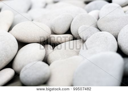 Lots of white pebbles on the beach. Shallow depth of field