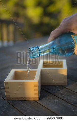 Pouring Sake in to Traditional Boxes