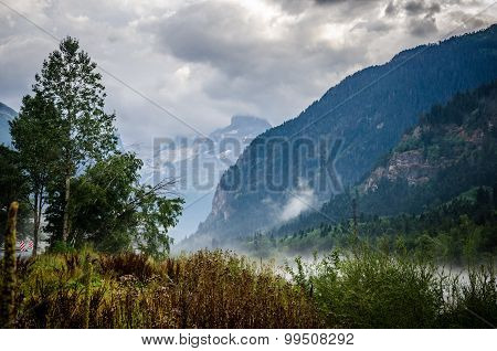 Foggy Autumn Landscape In Mountains