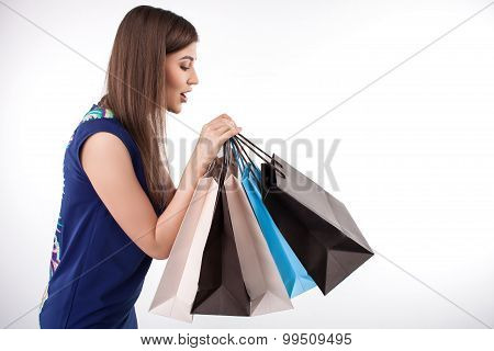 Cheerful young styled girl is a crazy shopaholic