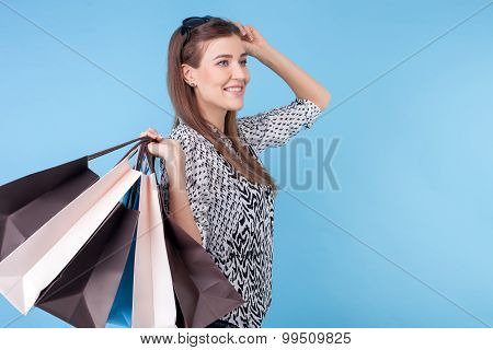 Attractive young girl wants to buy everything