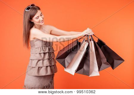 Cheerful young girl is going shopping with pleasure
