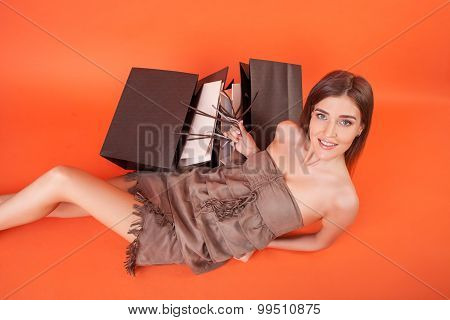 Attractive young woman is resting after shopping
