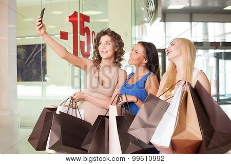 Beautiful young women are spending time in store
