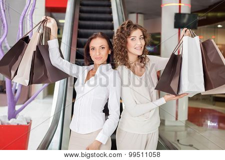 Beautiful young girls are going shopping with joy