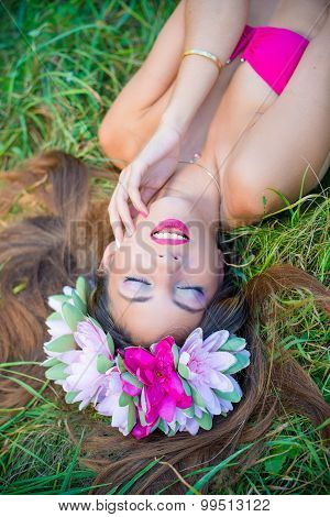 Pretty young lady with long hair in  wreath