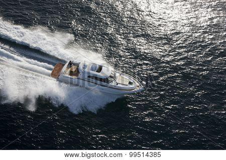 White Yacht Dashing Through The Ocean