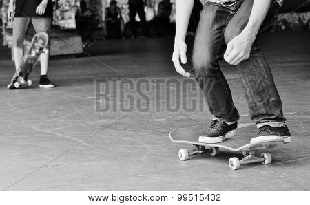 teenagers in jeans with sneakers trainers skateboard and graffiti behind wait for turn