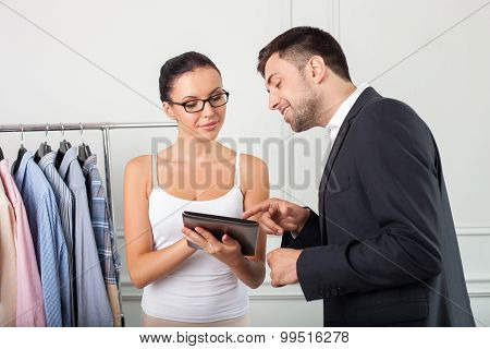 Cheerful young stylist is working with her client