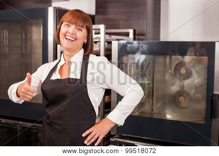 Pretty female baker is expressing positive emotions