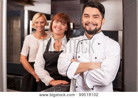 Professional friendly chefs are working in bakery