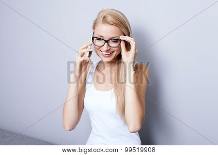 Young Blonde Woman Talking By Mobile Phone.
