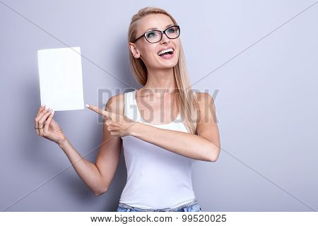 Smiling Young Blonde Woman With Empty Card.