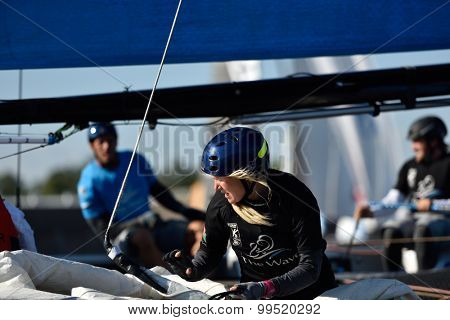 ST. PETERSBURG, RUSSIA - AUGUST 20, 2015: Two-time British gold medalist Sarah Ayton in The Wave, Muscat sailing team of Oman during 1st day of St. Petersburg stage of Extreme Sailing Series