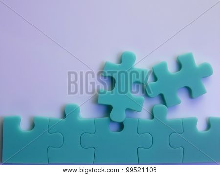 jig saw puzzle joined together -team work