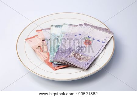 malaysia currency on dinner plate