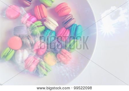 Macaroons On A White Plate On White Background Made With Abstract