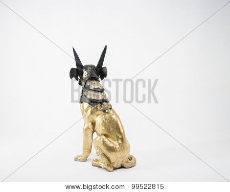 Guardian, sculpture of the Egyptian god Anubis, gold figure and black jackal