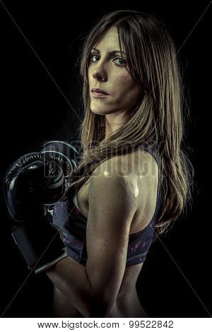Fight, strong woman athlete with boxing gloves