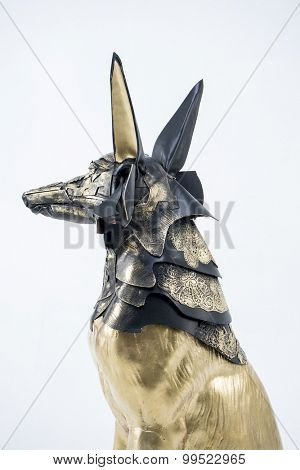 Mythology, sculpture of the Egyptian god Anubis, gold figure and black jackal