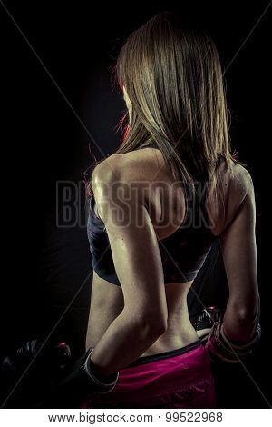 Strength, strong woman athlete with boxing gloves
