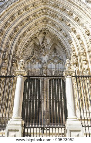 Iron fence, majestic facade of the cathedral of Toledo in Spain, beautiful church