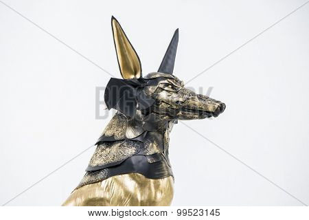 sculpture of the Egyptian god Anubis, gold figure and black jackal