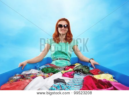 Woman sitting in clothes
