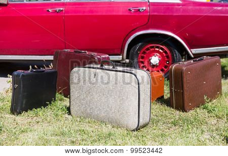 Old suitcases near the car