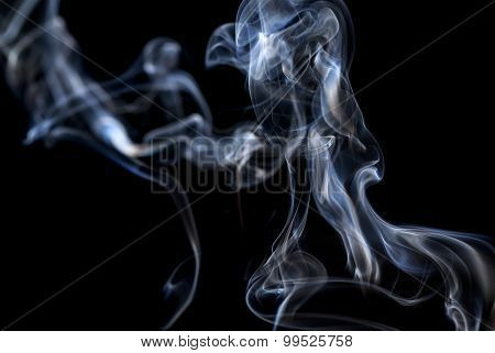 Abstract Smoke On A Black Background.