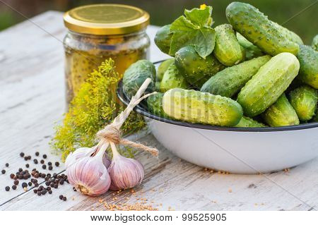 Cucumbers In Metal Bowl, Spices For Pickling And Jar Pickled Cucumbers On Table