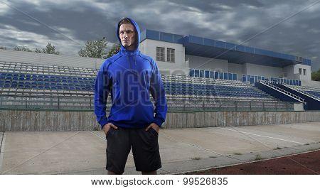 Athlete man posing over grunge stadium. Wide HDR shot. Composing retouch