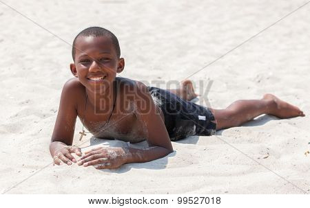 Portrait of a african boy on sand