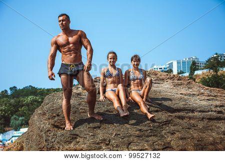 teacher on fitness with the pupils on a beach