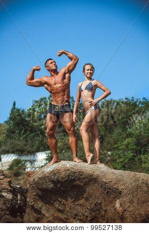 teacher on fitness with the pupil on a beach