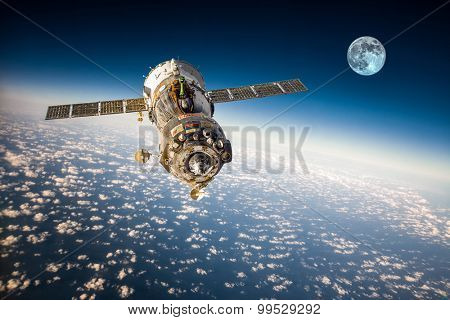 Spacecraft Soyuz orbiting the earth. Elements of this image furnished by NASA.