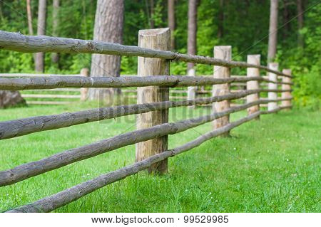 Rural Wooden Fence With Green Lawn, Part Of Farm Cattle-pen