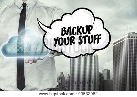 Backup your stuff text on cloud computing theme with businessman